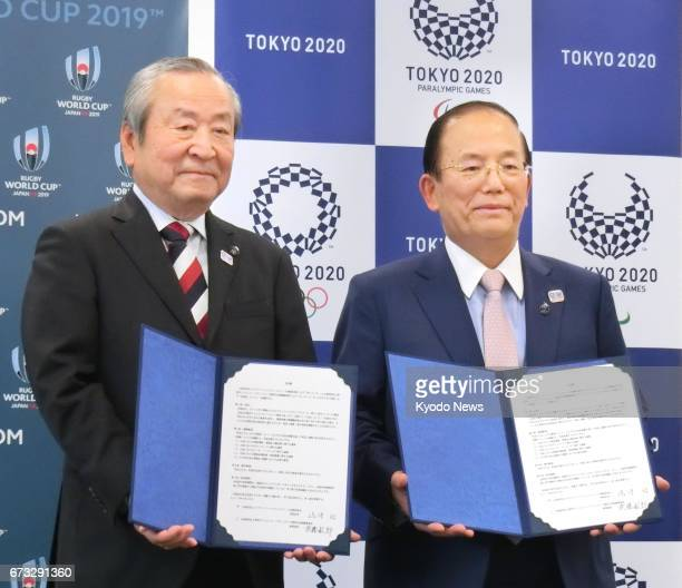 Toshiro Muto chief executive officer of the organizing committee of the 2020 Tokyo Olympics and Akira Shimazu chief executive officer of the...