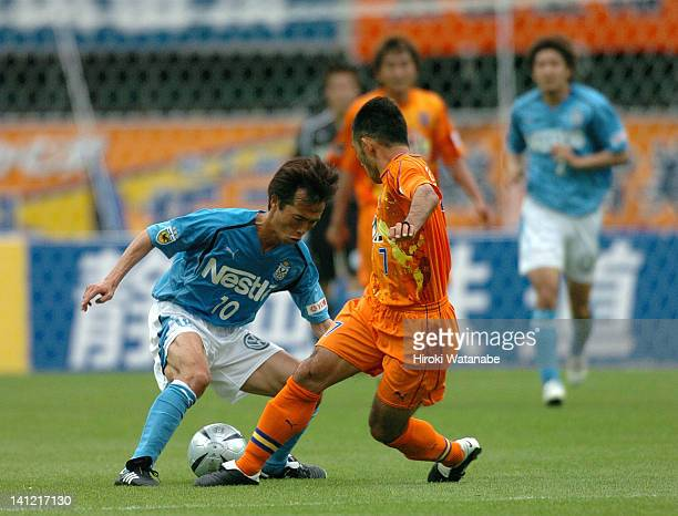 Toshiya Fujita of Jubilo Iwata and Teruyoshi Ito of Shimizu SPulse compete for the ball during the JLeague match between Shimizu SPulse and Jubilo...