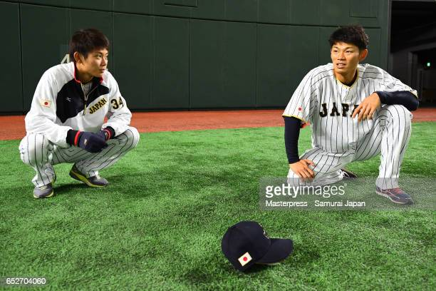 Toshiya Okada and Shota Ohno of Japan talk on the practice day during the World Baseball Classic at the Tokyo Dome on March 13 2017 in Tokyo Japan