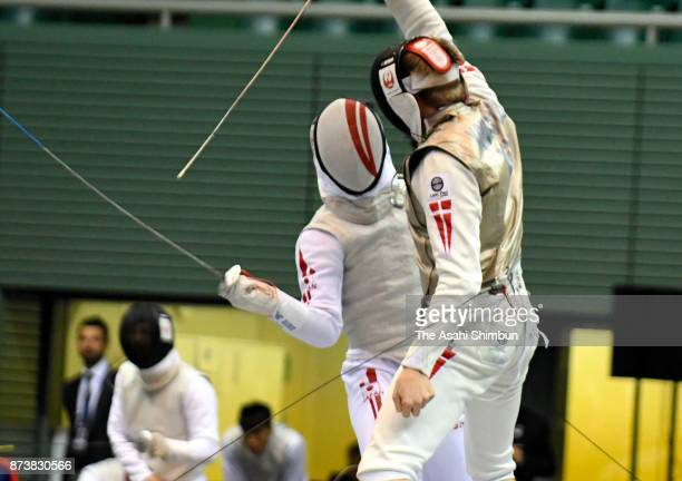 Toshiya Saito of Japan competes against Conrad Seibaek Kongstad of Denmark in the Men's Team Foil bronze medal matchduring day three of the Fencing...