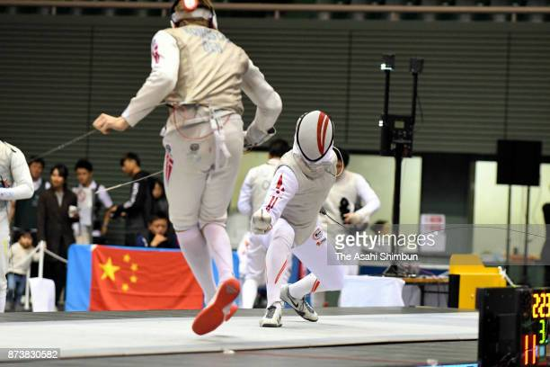 Toshiya Saito of Japan competes against Conrad Seibaek Kongstad of Denmark in the Men's Team Foil bronze medal match during day three of the Fencing...