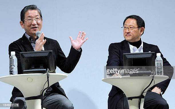 Toshiyuki Shiga chief operating officer of Nissan Motor Co left speaks as Akio Toyoda president of Toyota Motor Corp looks on during an event at the...