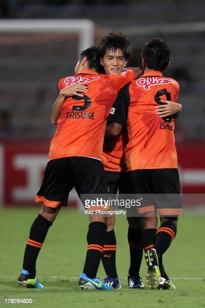 Toshiyuki Takagi of Shimizu S-Pulse celebrates the win with his teammates Taisuke Muramatsu and Hideki Ishige after the J.League match between...