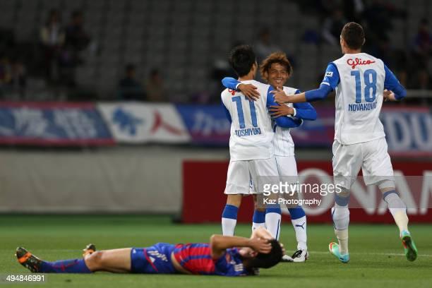 Toshiyuki Takagi of Shimizu SuPulse celebrates scoring his team's first goal with his teammate Yosuke Kawai and Milivoje Novakovic during the JLeague...