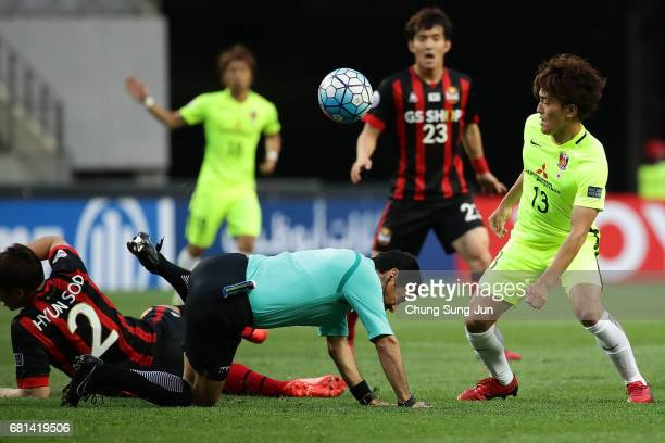 Toshiyuki Takagi of Urawa Red competes foe the nall with Hwang Hyun-Soo of FC Seoul during the AFC Asian Champions League Group F match between FC...