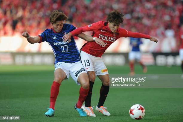 Toshiyuki Takagi of Urawa Red Diamonds and Ken Matsubara of Yokohama FMarinos compete for the ball during the JLeague J1 match between Urawa Red...