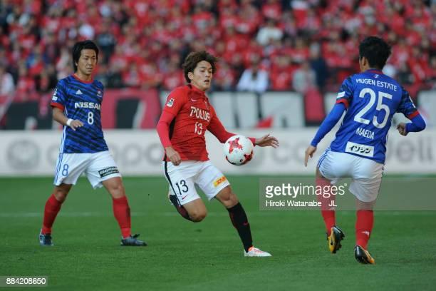 Toshiyuki Takagi of Urawa Red Diamonds and Naoki Maeda of Yokohama FMarinos compete for the ball during the JLeague J1 match between Urawa Red...