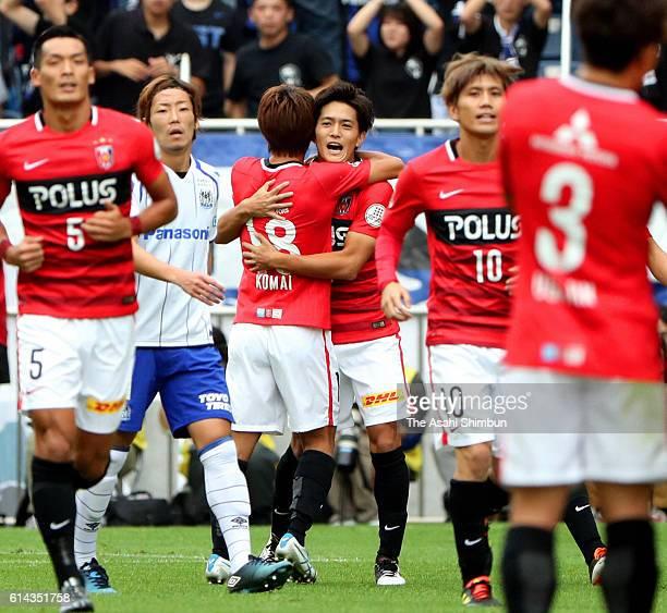 Toshiyuki Takagi of Urawa Red Diamonds celebrates scoring his team's first goal with his team mates during the JLeague match between Urawa Red...
