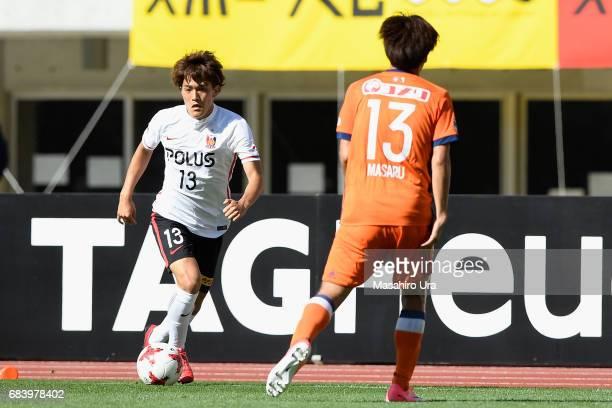 Toshiyuki Takagi of Urawa Red Diamonds takes on Masaru Kato of Albirex Niigata during the JLeague J1 match between Albirex Niigata and Urawa Red...