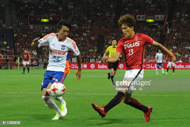 Toshiyuki Takagi of Urawa Red Diamonds takes on Teruki Hara of Albirex Niigata during the JLeague J1 match between Urawa Red Diamonds and Albirex...
