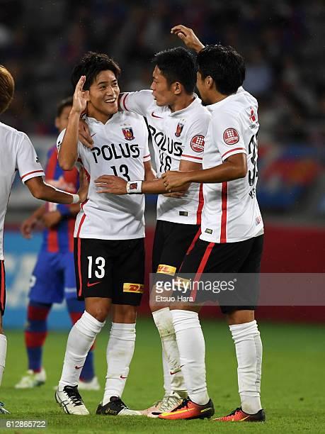 Toshiyuki Takagi of Urawa Red Diamonds#13 celebrates scoring his team's first goal during the JLeague Levain semi final first leg match between FC...
