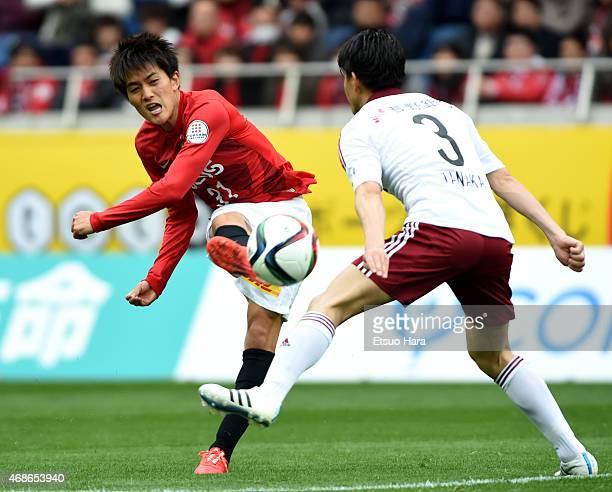 Toshiyuki Takagi of Urawa Reds shoots at goal during the JLeague match between Urawa Red Diamonds and Matsumoto Yamaga at Saitama Stadium on April 4...