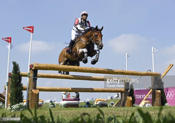 Toshiyuki Tanaka of Japan competes in the equestrian eventing cross country competition of the Tokyo Olympics on Aug. 1 at Sea Forest Cross-Country...