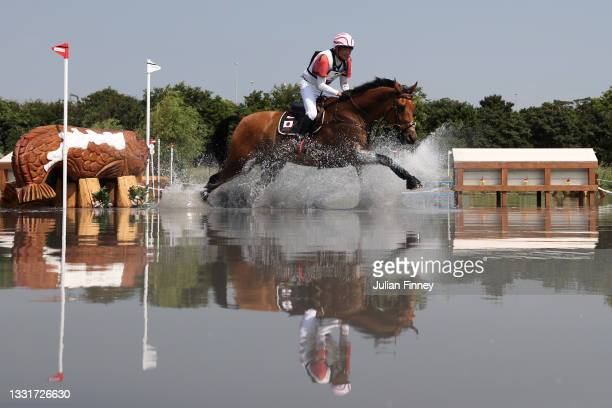 Toshiyuki Tanaka of Team Japan riding Talma D'Allou clears a jump during the Eventing Cross Country Team and Individual on day nine of the Tokyo 2020...