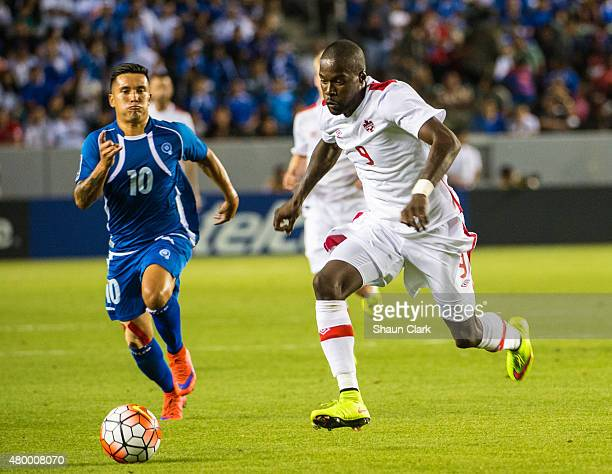 Tosiant Ricketts of Canada races upfield as Jaime Alas of El Salvador chases during the 2015 CONCACAF Gold Cup Group B match between El Salvador and...