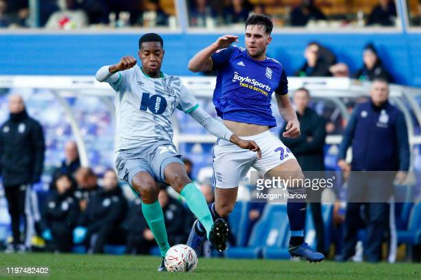 Tosin Adarabioyo of Blackburn Rovers battles for possession with Alvaro Gimenez of Birmingham City during the FA Cup Third Round match between...