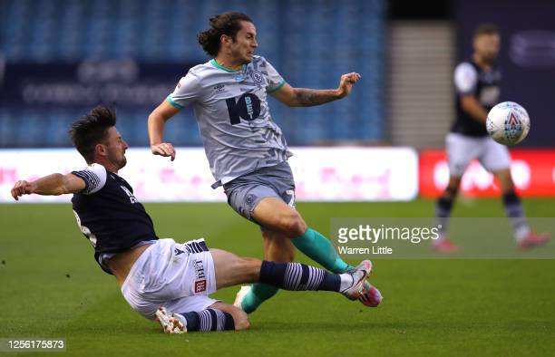 Tosin Adarabioyo of Blackburn Rovers is tackled by Ryan Leonard of Millwall during the Sky Bet Championship match between Millwall and Blackburn...