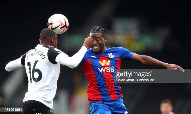 Tosin Adarabioyo of Fulham and Michy Matshuayi of Crystal Palace head the ball during the Premier League match between Fulham and Crystal Palace at...