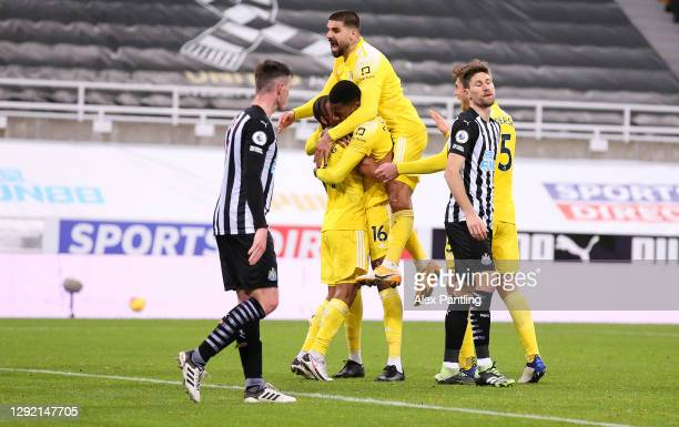Tosin Adarabioyo of Fulham celebrates their first goal with teammates, an own goal scored by Matt Ritchie of Newcastle United during the Premier...
