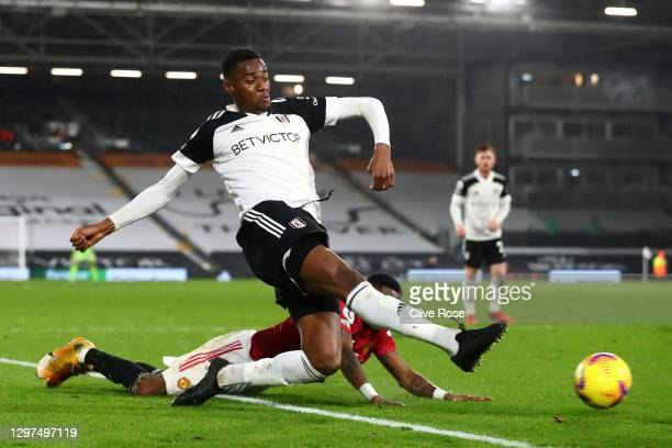 Tosin Adarabioyo of Fulham is challenged by Fred of Manchester United during the Premier League match between Fulham and Manchester United at Craven...