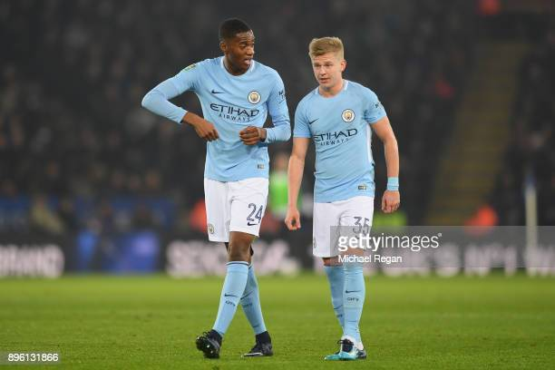 Tosin Adarabioyo of Manchester City speaks to team mate Oleksandr Zinchenko during the Carabao Cup Quarter-Final match between Leicester City and...