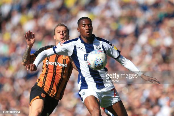 Tosin Adarabioyo of West Bromwich Albion and Kamil Grosicki of Hull City during the Sky Bet Championship match between West Bromwich Albion and Hull...