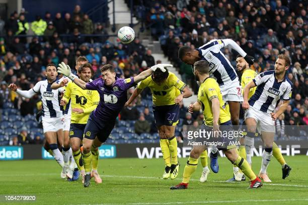 Tosin Adarabioyo of West Bromwich Albion heads as outfield player Richard Smallwood of Blackburn Rovers plays in goal after the injury to David Raya...