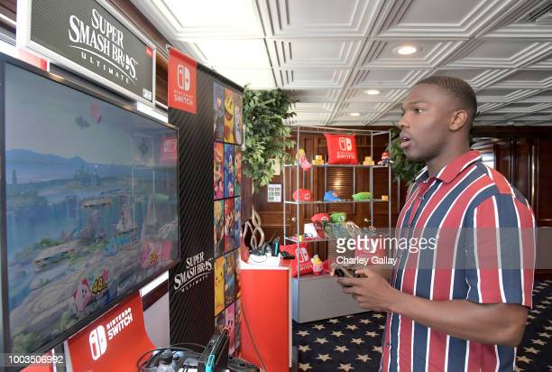 Tosin Cole tests his skills on Super Smash Bros Ultimate for Nintendo Switch at the Variety Studio at ComicCon 2018 on July 21 2018 in San Diego...