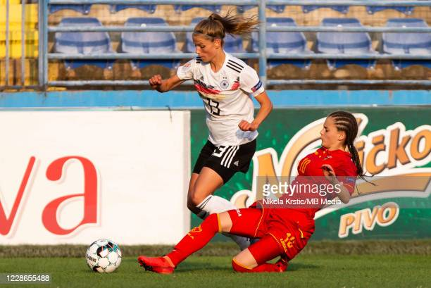 Toskovic of Montenegro tackles Sara Dabritz of Germany during the UEFA Women's EURO 2022 Qualifier match between Montenegro and Germany at Pod...