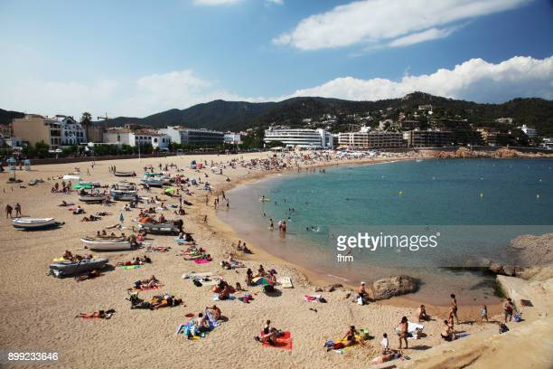 Tossa de Mar - beach with many tourists (Catalonia, Spain)
