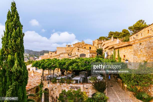 tossa de mar, spain. roofs and sea - spanische kultur stock-fotos und bilder