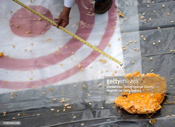 Tossed pumpkin is measured from where the biggest piece lands during the 4th Annual Punkin Chunkin competition at Experian in Costa Mesa on Monday,...