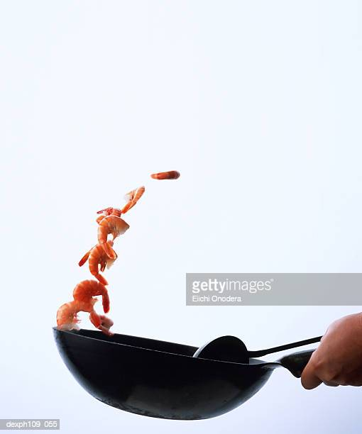 tossing prawns with wok - throwing stock pictures, royalty-free photos & images