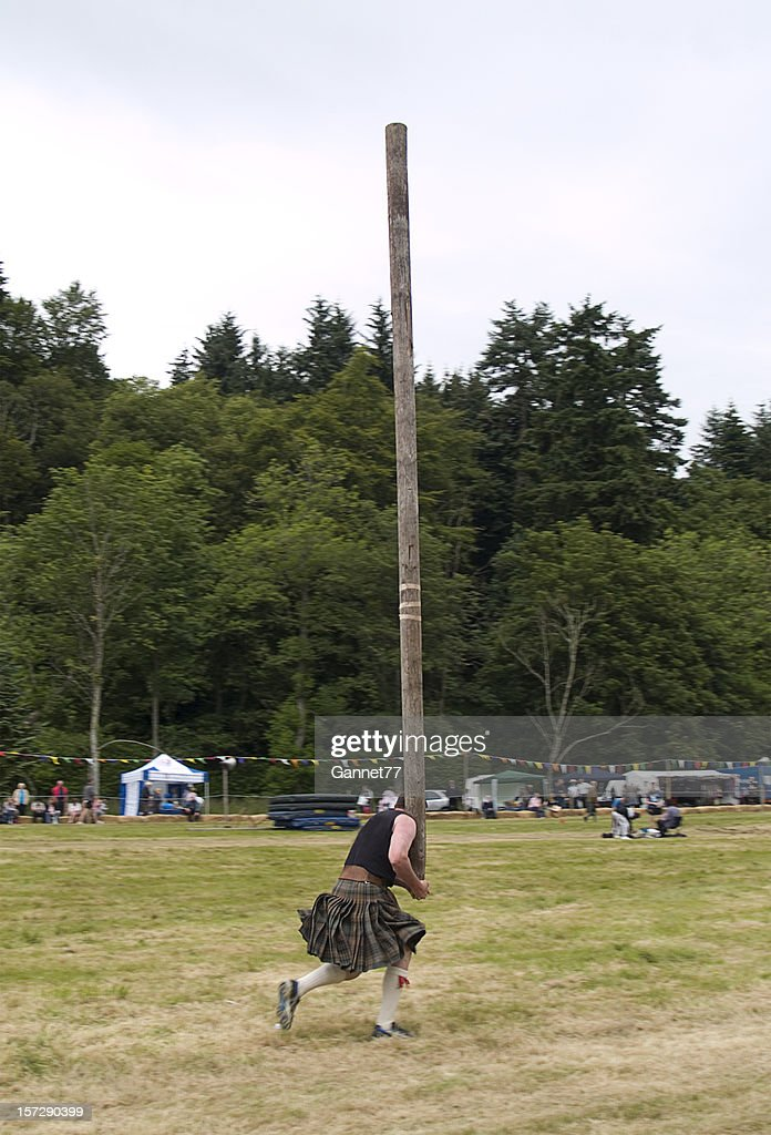 Tossing the Caber at a Highland Games event : Stock Photo