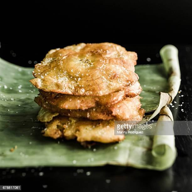 Tostones on banana leaf