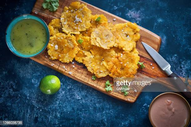 tostones puerto rican fried plantains - puerto rico stock pictures, royalty-free photos & images