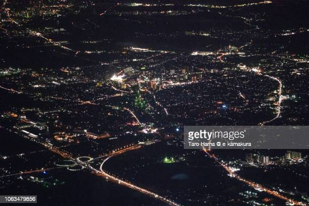 Tosu city in Saga prefecture and Kurume city in Fukuoka prefecture in Japan night time aerial view from airplane