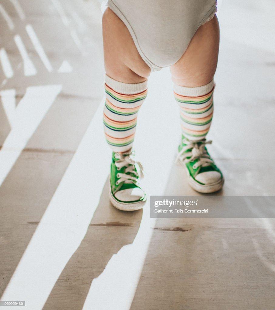 Tot in knee high striped socks : Stock-Foto