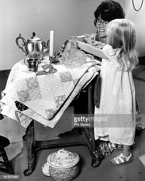 OCT 17 1974 OCT 18 1974 OCT 23 1974 Tot Samples Candy From Antique Candy Jar Articles are among those that will be shown at seventh annual Golden...