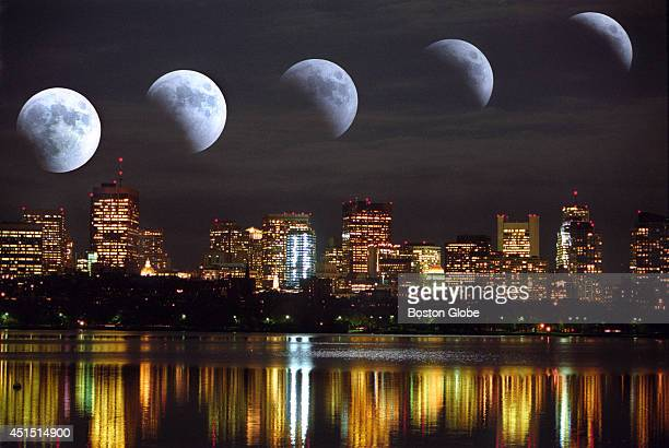 A total eclipse of the moon as photographed over the Boston Skyline from Memorial Drive in a multipleexposure starting at 934 pm with a crescent of...