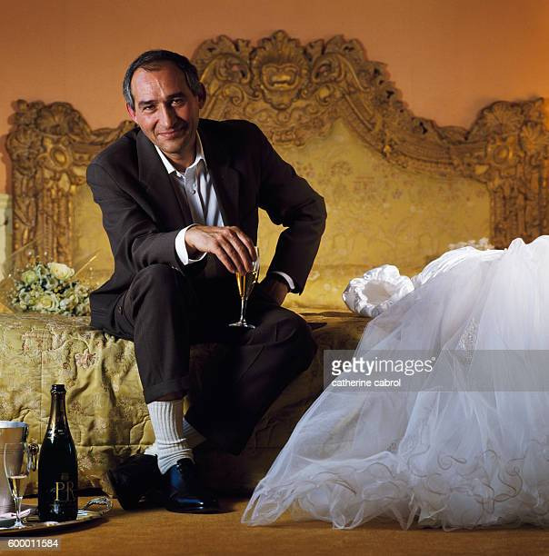 A total incongruity He is not married not a drinker He even forgot the white shirt He smiles 'So this could be my daughter's wedding'