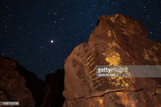 A total lunar eclipse and supermoon is seen over ancient Native American petroglyphs on January 20 2019 near Barstow California This is the last...