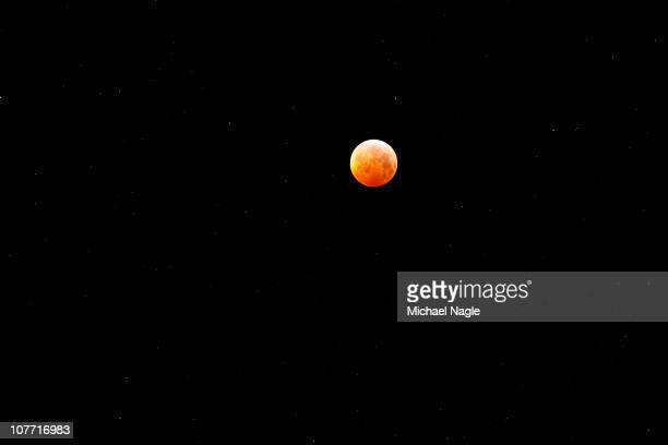 A total lunar eclipse occurs as the full moon is shadowed by the Earth on the arrival of the Winter Solstice the shortest day of the year on December...
