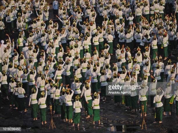 Total of 1800 dancers perform the Rejang Sandat Dance Ratu Segara, in the area of Tanah Lot Temple, Tabanan Regency, Bali, on August 18, 2018. For...