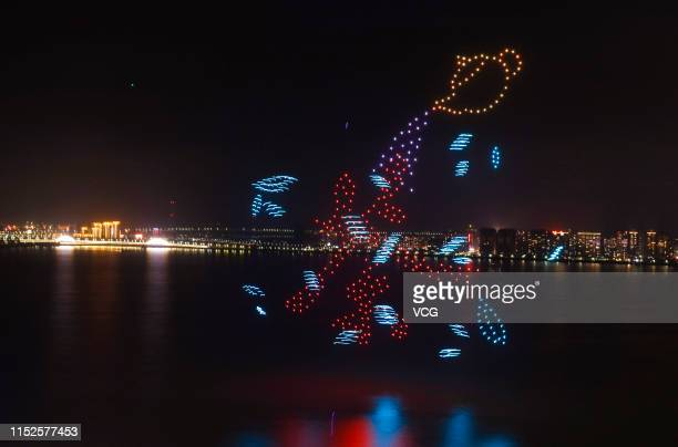 Total of 600 drones form a Chinese character reading 'tea' at Bali lake during a 15-minute light show to welcome the upcoming 2019 Jiujiang...