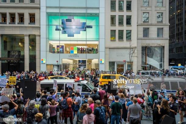 A total of 76 protesters were arrested after shutting down the Microsoft retail store in Manhattan and blocking traffic on Fifth Avenue on September...