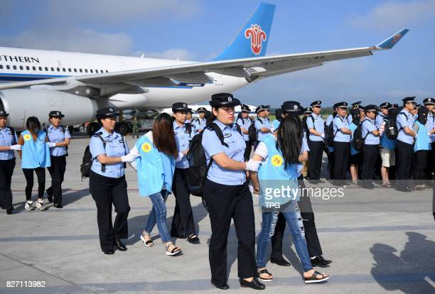 A total of 77 suspects in telecom and online fraud cases are brought back to China from Fiji at Changchun Longjia International Airport Changchun...