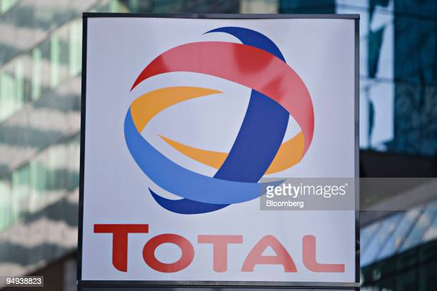 Total SA logo hangs at a gas station in front of the company's headquarters in Paris France on Wednesday Feb 11 2009 BP Plc Total SA and Royal Dutch...