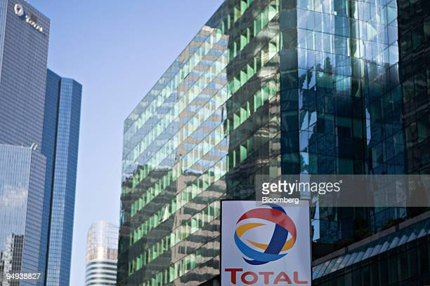 Total SA logo hangs at a gas station in front of the company's headquarters in Paris France on Wednesday Feb 11 2009 The company releases its...