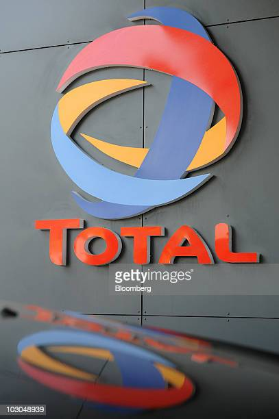 A Total SA logo is reflected in a car at a gas station in Paris France on Thursday July 22 2010 The company Europe's biggest oil refiner releases its...